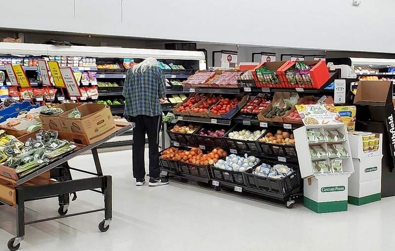 A customer checks out the produce section.