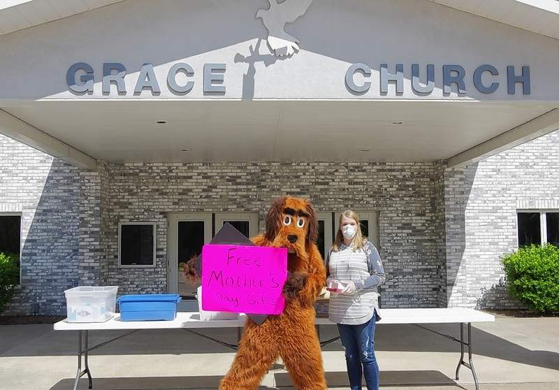 """Dancing Dog,"" aka D.W., helps advertise the free Mother's Day gifts the church was giving away on May 8 and 9, which included free personal Bibles."