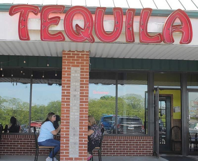 Two customers take advantage of the outdoor tables set up at Tequila's on Tuesday. Angela Isom is at left; Jo Levery is right.