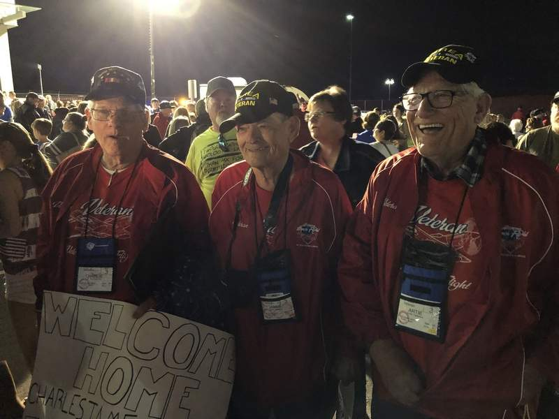 "Members of Honor Flight 6 enjoy the traditional ""Welcome Home"" celebration at Veterans Airport of Southern Illinois on May 14, 2019."