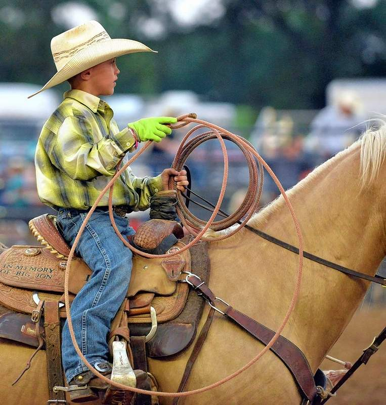 Braxton Davis, of Marion, rides out of the arena after competing in the team roping event.