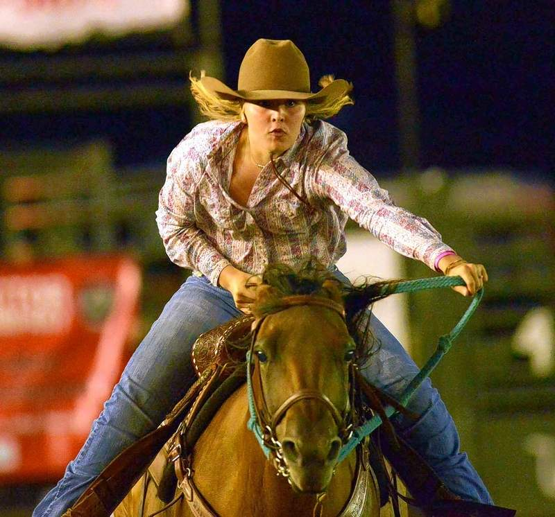 Mattie Wells of Omaha races to the finish line of the barrel races Friday night at the 2017 Saline County Fair.