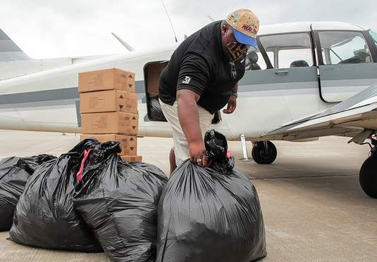 Marcellus Freeman, a Tuskegee Next aviation graduate and employee of the Will Group, a Chicago-area lighting and infrastructure firm, helps unload a shipment of N95 face masks Thursday morning at the Southern Illinois Airport in Murphysboro. The masks, donated by the Will Group, ultimately will be used by Carbondale-based SIH and shared with other community health and social service agencies across the region.