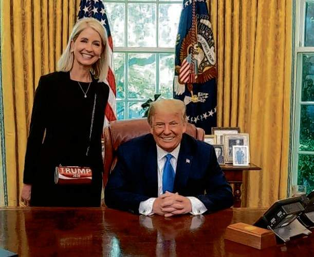 Rep. Mary Miller poses with President Trump during her successful campaign for Illinois' 15th District congressional seat.