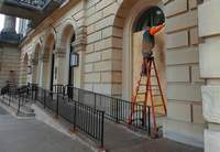 Crews board up windows at the State Capitol as a precaution.