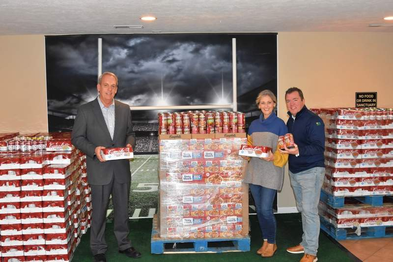"From left, Sen. Dale Fowler, Pastor Melissa McKinnies, and Senior Pastor Jason McKinnies of the Southern Illinois Worship Center with the first 1,000 cans of soup that kicked off the ""Together We Can"" drive in Southern Illinois."
