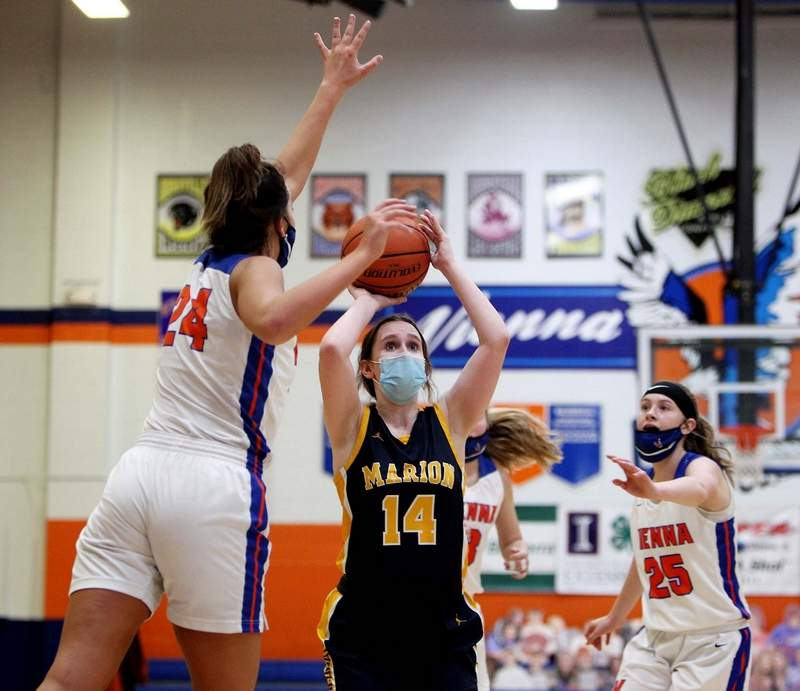 Marion sophomore Kristen Kadela puts up this shot past the defense of Vienna's Addison Bent (24) and Shaylee Moore (25) Saturday in a road non-conference game at Vienna High School.