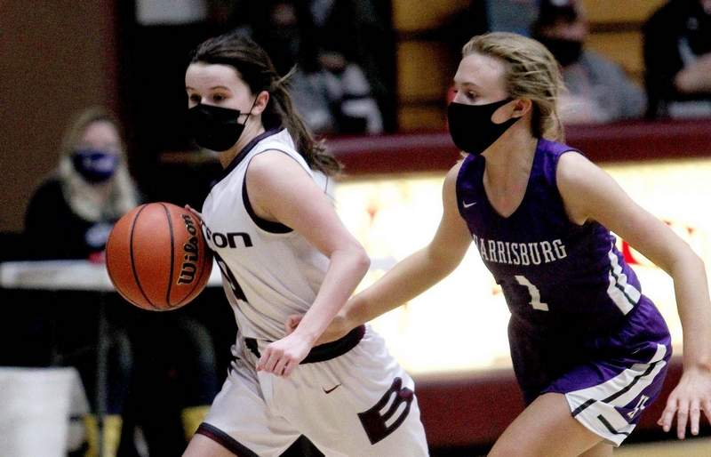 Benton's Jacey Eubanks dribbles past the defense being applied by Harrisburg's Kailyn Moss in the first half Friday night at Rich Herrin Gymnasium.