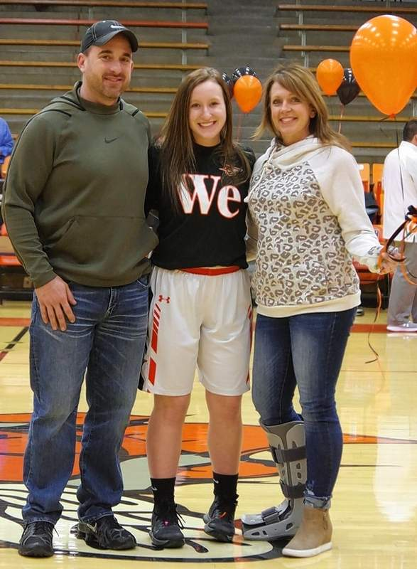 Peyton Clendenin, with parents Roger and Eleanor Clendenin.