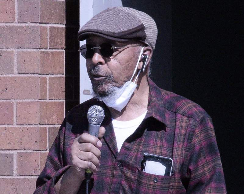 Carlton Smith speaks Saturday during a rally at the Eurma C. Hayes Center.