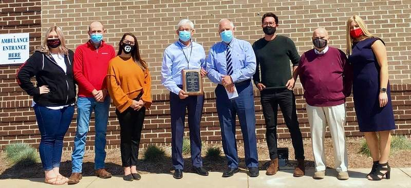 Marshall Browning CEO Dan Eaves, surrounded by hospital personnel, holds their Citizen of The Year plaque presented by the chamber in recognition of the fight the hospital and other health care workers waged against COVID-19 in Du Quoin and Perry County.