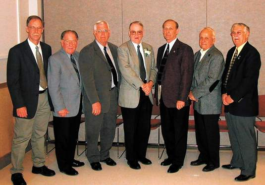 Former Carbondale mayor Neil Dillard was honored by the mayors of area communities at his last city council meeting in 2003. Pictured (from left) are Tom Redmond, the then-development services director for the city of Carbondale; Elwyn Cheatum, mayor of Kinmundy; Joe Bisch, mayor of Grayville; Dillard; Dick Deitz, mayor of McLeansboro; Vic Ritter, mayor of Herrin; and Leonard Ferguson, mayor of Salem.