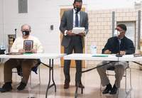 Curtis Winston photo Departing District 95 board members Gary Shepherd (left) and Carlton Smith (right) are presented plaques of appreciation by Superintendent Daniel Booth.