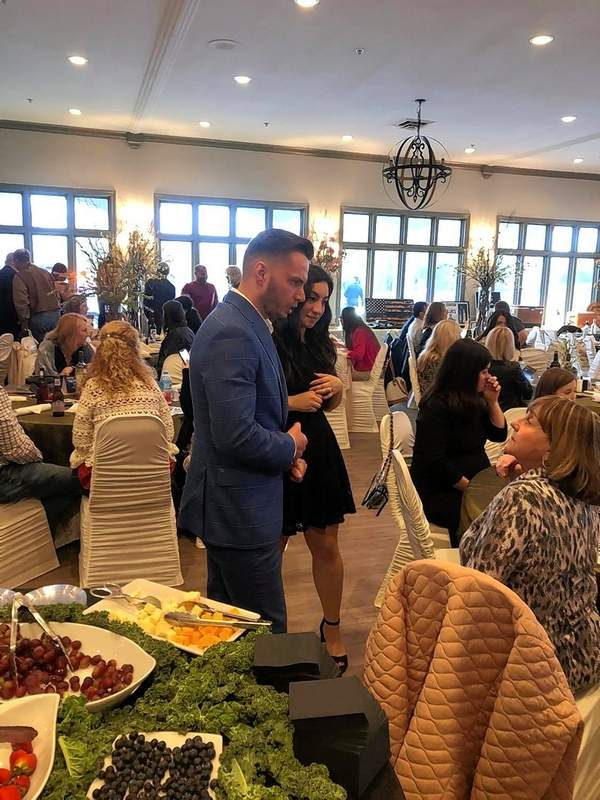 """Williamson County Circuit Clerk Justin Maze and his wife, Valerie, speak to other guests during the """"cocktail hour"""" at the 9th Annual K-9 Fundraiser in Marion earlier this month."""