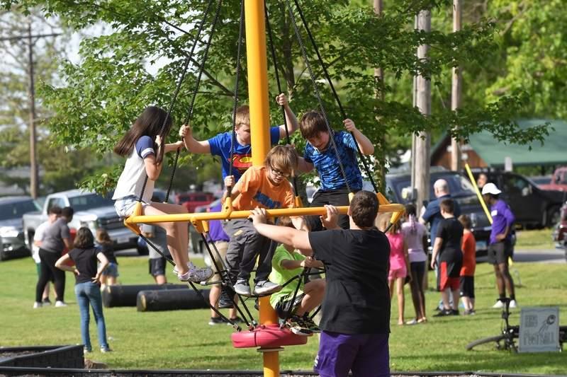 East Side students enjoy playground equipment.