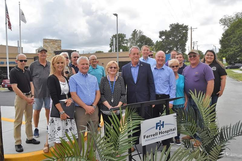 Ferrell Hospital officials, city of Eldorado officials and members of the community gather for a group photo after the announcement of the Benton Street expansion Monday.