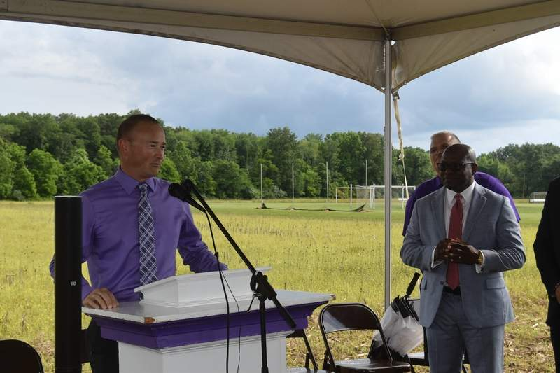 Dr. Eric Witges, principal of West Side School and future superintendent for Harrisburg Unit 3, speaks at the groundbreaking for the district's new pre-K building.