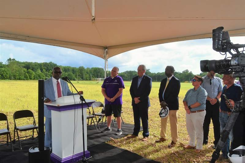 TRAVIS DENEAL PHOTODee Brown, president and CEO of the P3 Group, which is developing the pre-K building project at Harrisburg, speaks at the groundbreaking ceremony.
