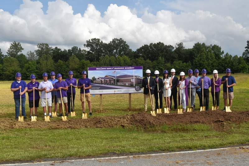 Members of Harrisburg Unit 3, the P3 Group, Harrisburg School Board and community leaders pose for the groundbreaking on the new pre-K building.