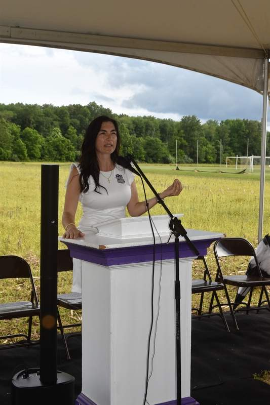 Harrisburg Unit 3 Pre-K Coordinator Pam Rizkallah speaks at the groundbreaking of the Bulldog Early Learning Academy Monday afternoon.