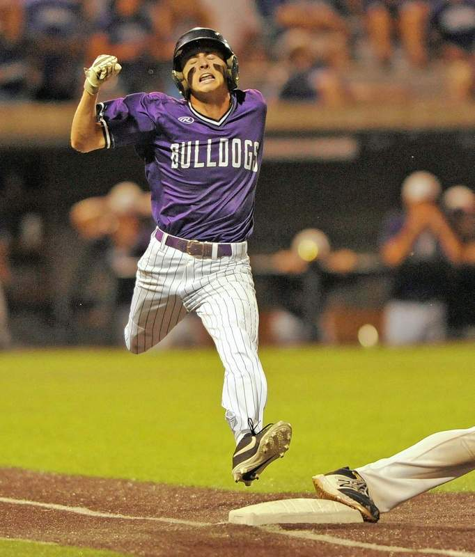 Harrisburg's Adrew Bittle fails to beat the throw to first base in the 7th and final inning of play.