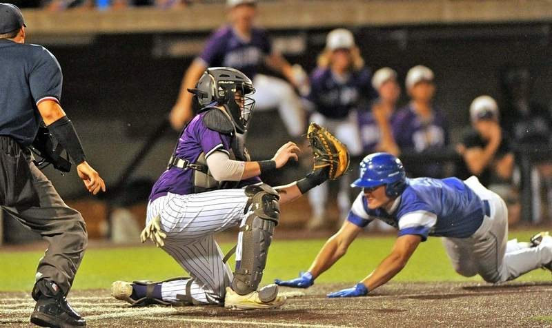 JEFF JONES PHOTOCatcher, Krayton Morse, makes the tag for the out at home plate in the fifth inning.