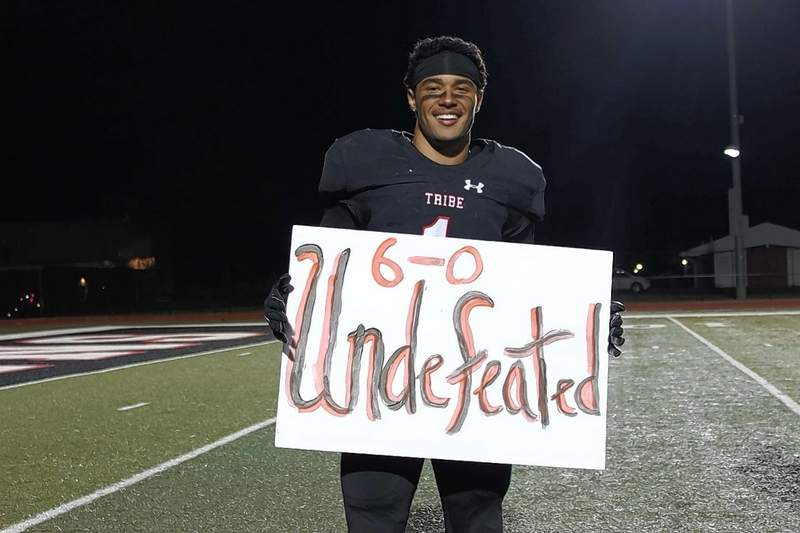 Johnston City's Austin Brown is all smiles following the end of a perfect season in 2020.