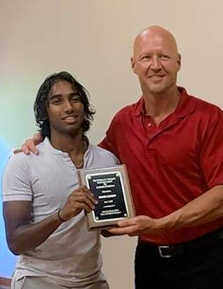 David Gomes is awarded the prestigious Theobald Award by Derek Beard, honoring both his athletic and academic abilities.