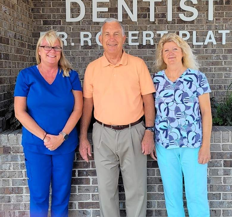 Dr. Robert Platt, center, in front of his dental office at 2321 Old Plank Road. At left is Stacey Westerman, office manager. At right is Sandy Walls, dental assistant. Not pictured: Tiffany Yearian, dental hygienist.
