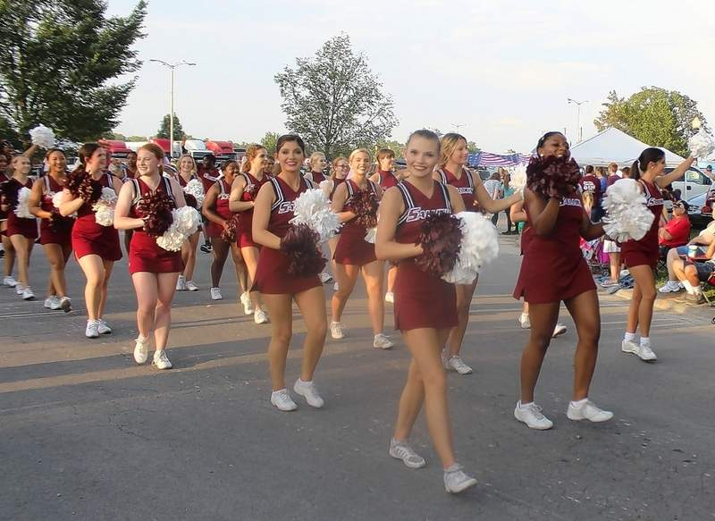 Saluki cheerleaders take part in the opening parade of the 2021 Du Quoin State Fair.