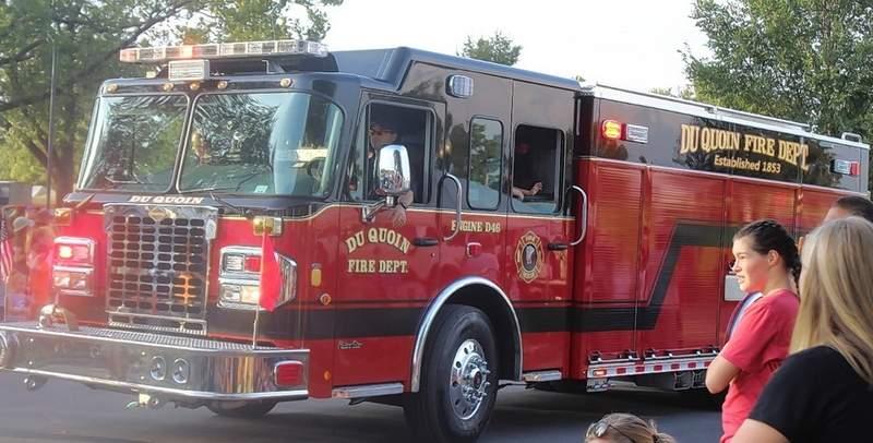 Paradegoers applaud the Du Quoin Fire Department.