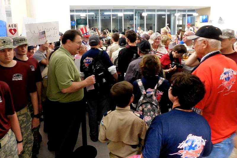 A crowd fills Veterans Airport near Marion waiting to greet the returning heroes from the March 2017 Honor Flight.