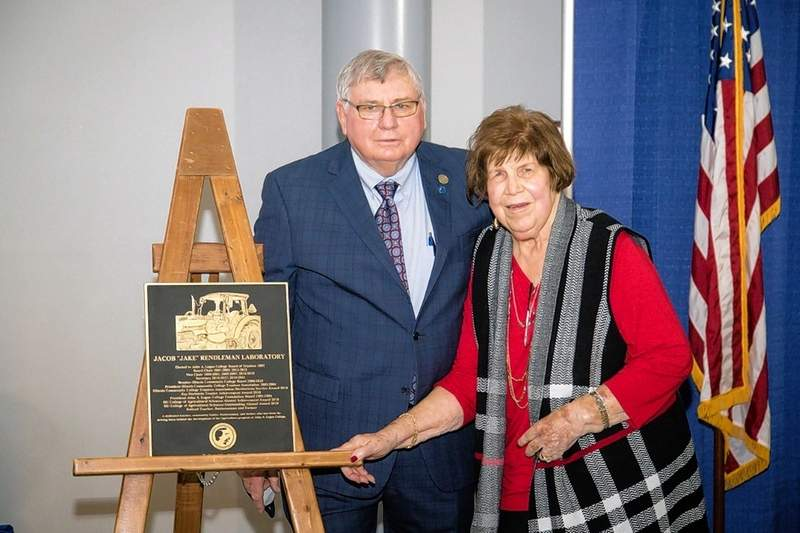 """Jake and Carolyn Rendleman with the plaque during the ceremony dedicating the Jacob """"Jake"""" Rendleman Laboratory at JALC in March."""
