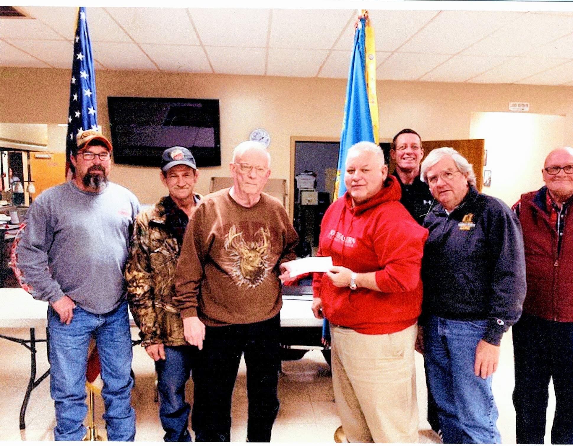 Tommy Stephens, left, Terry Ferrell, Greg Hodson (Sons commander receiving check), Steve Vinyard (Sons adjutant presenting check), Brandon Henshaw (Sons junior vice president), Bruce Boone and Mickey Pankey (sons senior vice president).