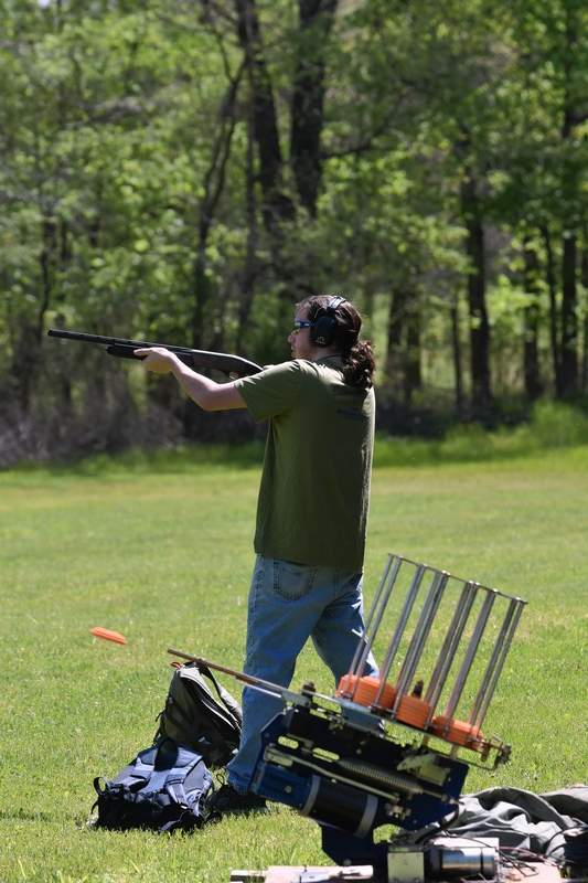 Wilson DeNeal prepares to shoot a clay target as it comes out of the thrower.